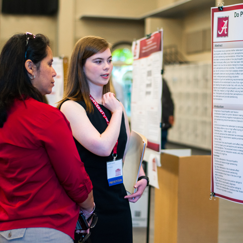 female student presenting a research poster